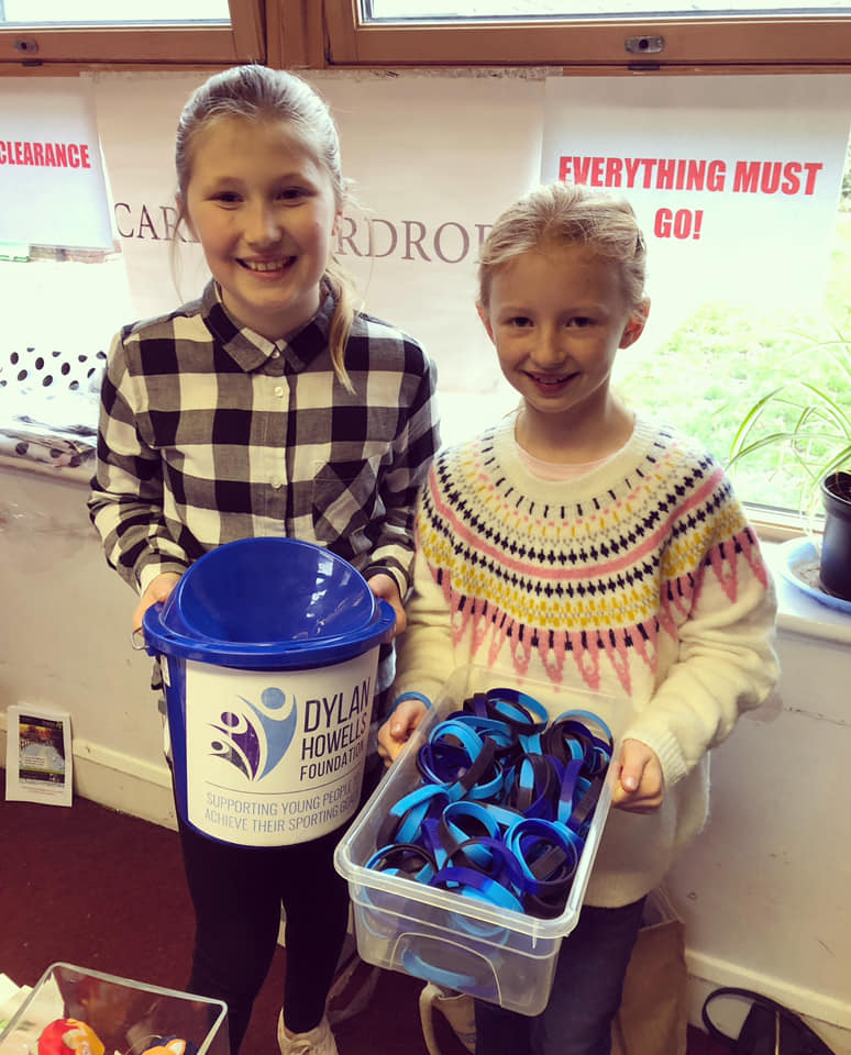 Megan & Minnie raising funds at Claygate Primary Christmas Bazaar – great ef…